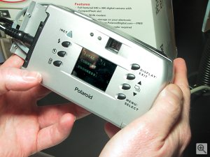 Polaroid's PDC640M digital camera in action - note transfer status on the LCD display. Copyright (c) 2001, Michael R. Tomkins, all rights reserved. Click for a bigger picture!