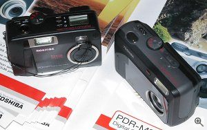 Toshiba's PDR-3300 digital camera compared with the previous PDR-M71 model. Copyright © 2002, Michael R. Tomkins. All rights reserved. Click for a bigger picture!