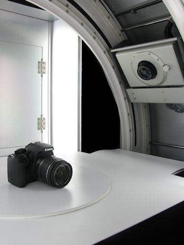 Inside the Photosimile 5000, showing the camera platter and turntable with subject. Photo provided by Ortery Technologies. Click for a bigger picture!