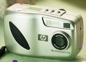 Hewlett Packard's PhotoSmart 318 digital camera. Courtesy of Hewlett Packard, with modifications by Michael R. Tomkins. Click for a bigger picture!