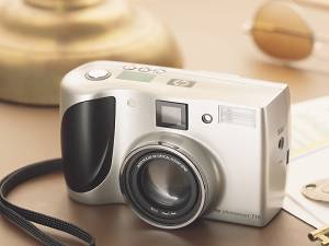 Hewlett Packard's PhotoSmart 715 digital camera. Courtesy of Hewlett Packard, with modifications by Michael R. Tomkins. Click for a bigger picture!