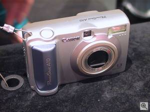 Canon's PowerShot A10 digital camera, front right  quarter view. Copyright (c) 2001, Michael R. Tomkins, all rights reserved. Click for a bigger picture!