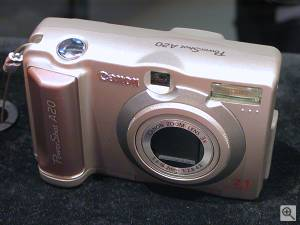 Canon's PowerShot A20 digital camera, front right  quarter view. Copyright (c) 2001, Michael R. Tomkins, all rights reserved. Click for a bigger picture!
