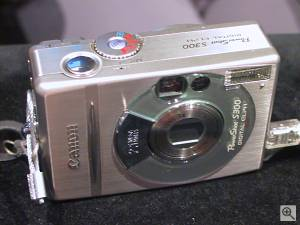 Canon's PowerShot S300 Digital ELPH digital  camera, front right quarter view. Copyright (c) 2001, Michael R. Tomkins, all rights reserved. Click for a bigger picture!