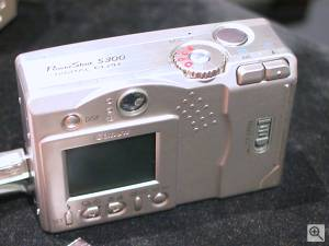 Canon's PowerShot S300 Digital ELPH digital  camera, rear left quarter view. Copyright (c) 2001, Michael R. Tomkins, all rights reserved. Click for a bigger picture!
