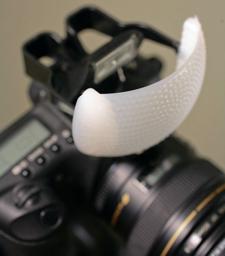Gary Fong Puffer pop-up flash diffuser, mounted on a Canon DSLR. Photo provided by Gary Fong Inc. Click for a bigger picture!
