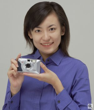 A model holds Casio's QV2100 digital camera to demonstrate the size. Courtesy of Casio Computer Co. Ltd. Click for a bigger picture!
