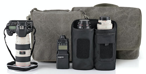 The Retrospective camera shoulder bags (background) and lens changer shoulder bags (foreground) feature tough, understated designs in either Pinestone Cotton canvas, or Black Poly Spun canvas. Photo provided by Think Tank Photo LLC. Click for a bigger picture!