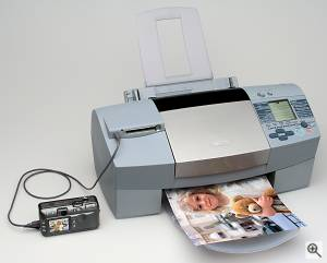 Canon's S820D Bubble Jet printer with PowerShot S40 digital camera attached. Courtesy of Canon, with modifications by Michael R. Tomkins. Click for a bigger picture!