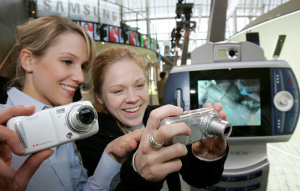 Samsung's camera phones on display. Courtesy of Samsung, with modifications by Michael R. Tomkins. Click for a bigger picture!