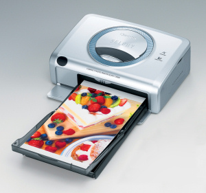 Canon's SELPHY CP600 dye sublimation photo printer. Courtesy of Canon, with modifications by Michael R. Tomkins. Click for a bigger picture!
