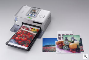 Canon's SELPHY CP710 printer. Courtesy of Canon, with modifications by Michael R. Tomkins. Click for a bigger picture!
