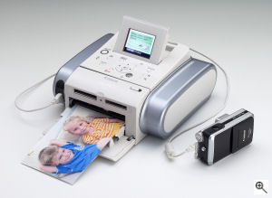 Canon's SELPHY DS810 printer. Courtesy of Canon, with modifications by Michael R. Tomkins. Click for a bigger picture!