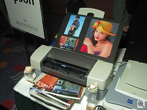Epson's Stylus Photo 1280 printer at the DigitalFocus 2001 press event, shown with numerous print samples. Copyright (c) 2001, Michael R. Tomkins, all rights reserved. Click for a bigger picture!