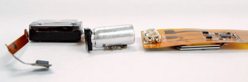This supercapacitor-powered LED flash module reference design, developed by ON Semiconductor, uses a thin CAP-XX HA230 supercapacitor (on the underside) and the ON Semiconductor NCP5680 flash driver to drive high-current Lumileds LEDs. Also pictured (left) for comparison is the Nokia N82 xenon flash solution with its large, cylindrical electrolytic capacitor. Photo and caption provided by CAP-XX Ltd. Click for a bigger picture!