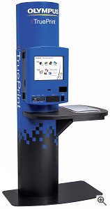 Olympus's TruePrint TP-200 self-service photo kiosk. Courtesy of Olympus America Inc., with modifications by Michael R. Tomkins. Click for a bigger picture!