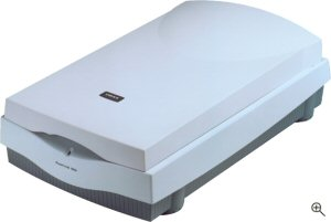 UMAX's PowerLook 1000 flatbed scanner with transparency adapter. Courtesy of UMAX Technologies Inc.,with modifications by Michael R. Tomkins. Click for a bigger picture!