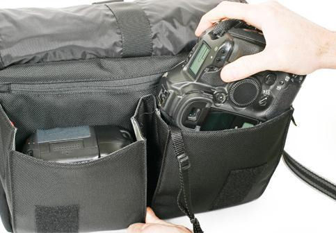 Canon digital SLR being placed in the Urban Disguise 70 Pro shoulder bag. Photo provided by Think Tank Photo LLC. Click for a bigger picture!