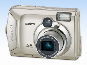 Sanyo's Xacti DSC-S5 digital camera. Courtesy of Sanyo, with modifications by Michael R. Tomkins. Click for a bigger picture!