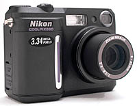 Nikon's Coolpix 880 digital camera, front right quarter view. Copyright (c) 2000, The Imaging Resource, all rights reserved.