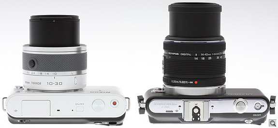 Nikon J1 vs Olympus E-PM1 Top Extended