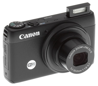 Canon S120 review -- Front right quarter view with flash