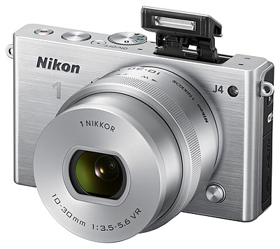 Nikon J4 Review -- 3/4 front view, silver with flash