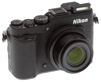 Nikon P7800 Review -- Front left view with flash extended