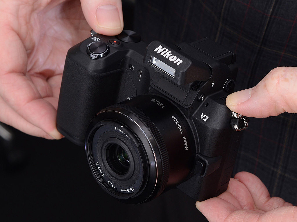 Camera Nikon Smallest Dslr Camera nikon v2 review initial test the has some new bulges and protuberances vs v1 but overall camera is still impressively small this shot shows built in flash