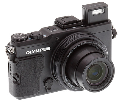 Olympus XZ-2 review: Three quarter view with flash