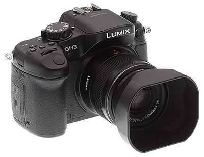 Panasonic GH3 review -- Front quarter view with lens