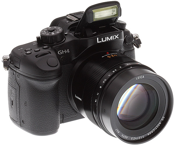 Panasonic GH4 Review -- 3/4 front right view with flash deployed