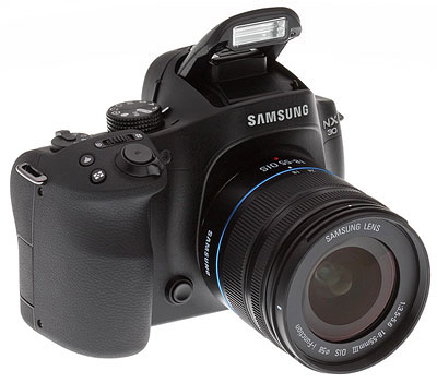 Samsung NX30 review -- three quarter from right view with flash extended