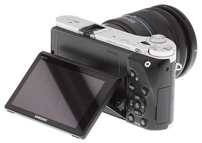 Samsung NX300 Review -- Rear 3/4 view showing AMOLED monitor articulated
