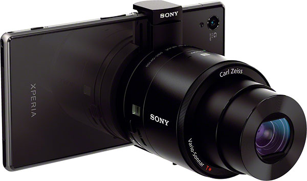 Sony QX100 review -- Front quarter view with smartphone