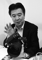 Nikon's Toshiaki Akagi. Copyright © 2012, Imaging Resource. All rights reserved. Click for a bigger picture!