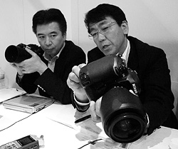 Nikon's Toshiaki Akagi and Kenji Suzuki. Copyright © 2012, Imaging Resource. All rights reserved. Click for a bigger picture!