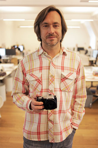 Industrial designer Marc Newson with the Pentax K-01 compact system camera. Photo provided by Pentax Ricoh Imaging Co. Ltd. Click for a bigger picture!