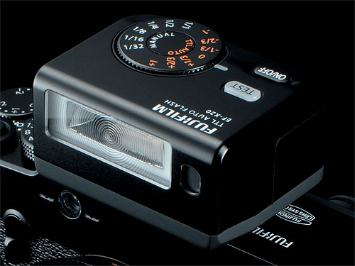 The EF-X20 flash strobe mounted on Fujifilm's X-Pro1 compact system camera. Photo provided by Fujifilm Corp. Click for a bigger picture!