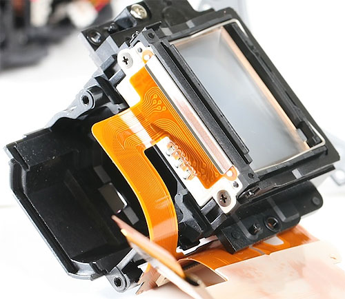 The focusing screen / pentaprism assembly removed from the mirror box. Photo copyright © 2012, Roger Cicala. Used by permission.