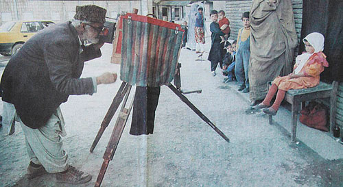A 'Kamra-e-Faoree' photographer with box camera in Kabul, Afghanistan ca. 1996. Photo courtesy Tony Ashby / Western Australian, via Afghan Box Camera Project. Click for a bigger picture!