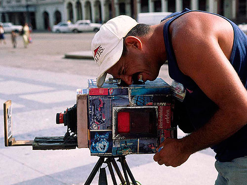 A Cuban photographer performs the final step in the box camera process. Photo courtesy of Billy Baque / Baque Photography. Click for a bigger picture!