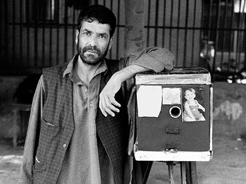 Kamra-E-Faoree street photographer Qalam Nabi, with his box camera. Photo courtesy of the Afghan Box Camera Project / Kickstarter. Click for a bigger picture!