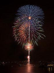 July 4th fireworks reflected in the ocean off Long Beach, CA, by Celeste Mookherjee