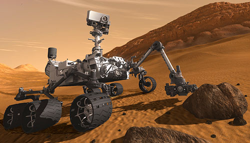 Artist's rendering of the Curiosity rover examining a martian rock with its articulated arm. Image provided by NASA / JPL. Click for a bigger picture!