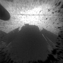 Hazard Avoidance camera shot with dust cover on. Photo provided by NASA/JPL-Caltech. Click for a bigger picture!
