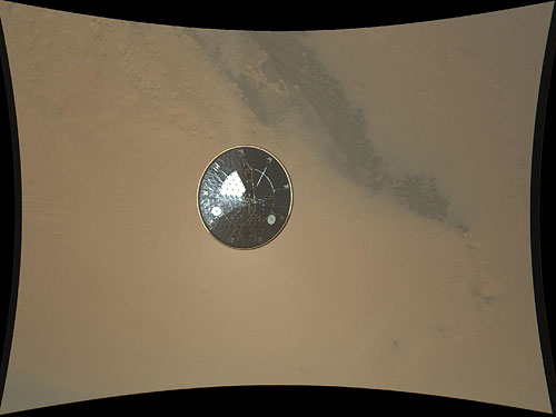 The first public high-res image from the MARDI camera shows the Curiosity rover's heat shield falling away, some three seconds after separation. Photo provided by NASA/JPL-Caltech/MSSS. Click for a bigger picture!