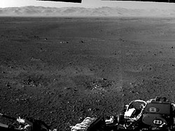 A two-image panorama from the nav cams, showing the rim of Gale Crater in the distance. Photo provided by NASA/JPL-Caltech. Click for a bigger picture!