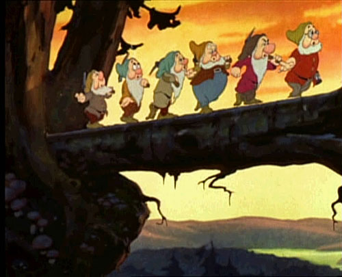 I have to wonder why there are only 6 Dwarves. Which one is missing? It's kind of blurry, but I'm pretty sure the one in the front is carrying a Sony 18-200. The silver one. Public domain image from 1937 Snow White trailer, courtesy Wikipedia.